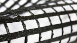 Polyester mining grids with high tenacity and wide range of tensile strength