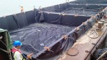 Geotextile container with resistance against abrasion, UV, chemicals and immersion corrosion
